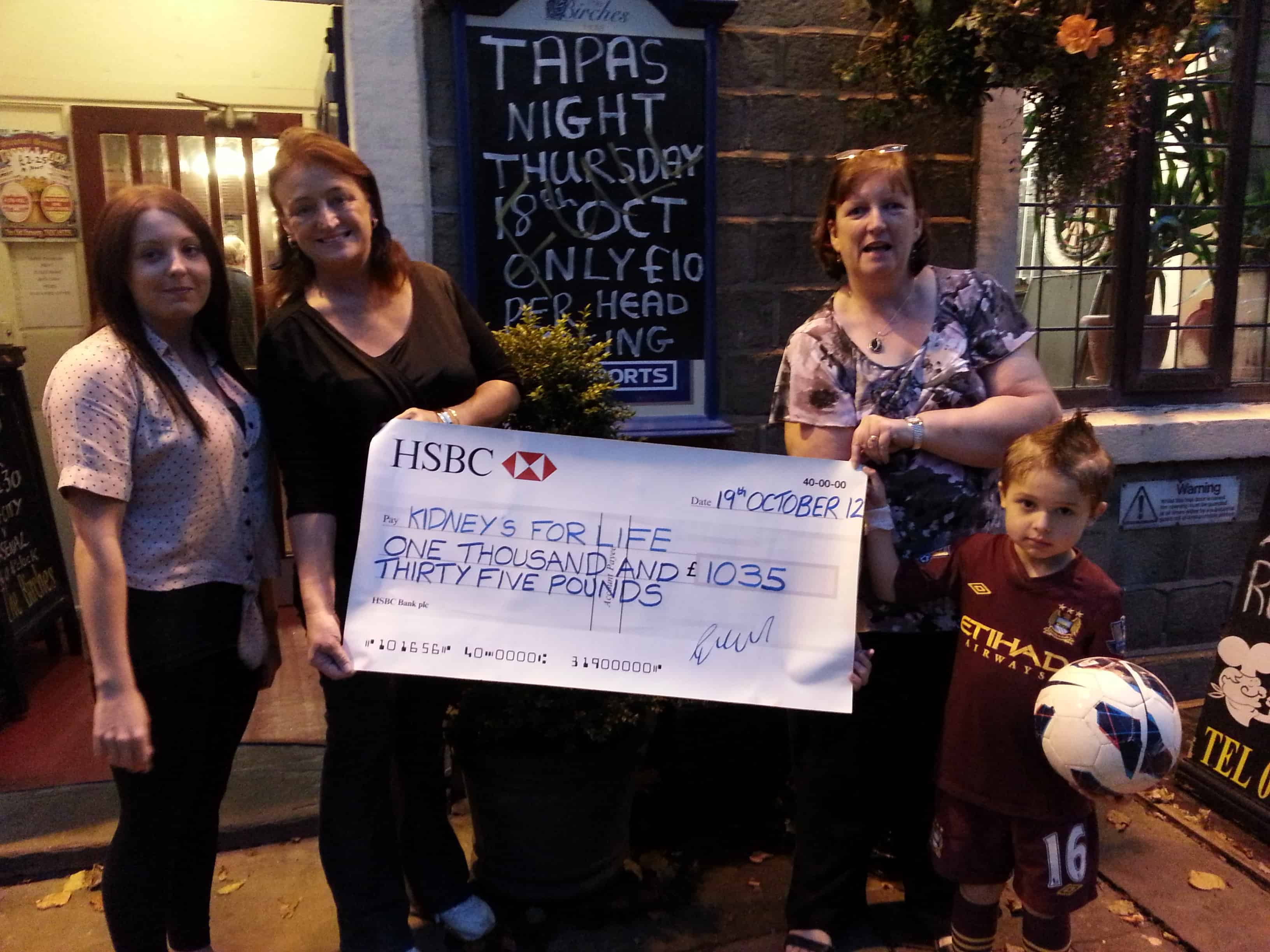 The Birches Hotel staff present cheque to Kidneys For Life's Irene Chambers.
